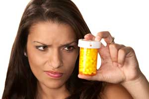 Woman with diet pills